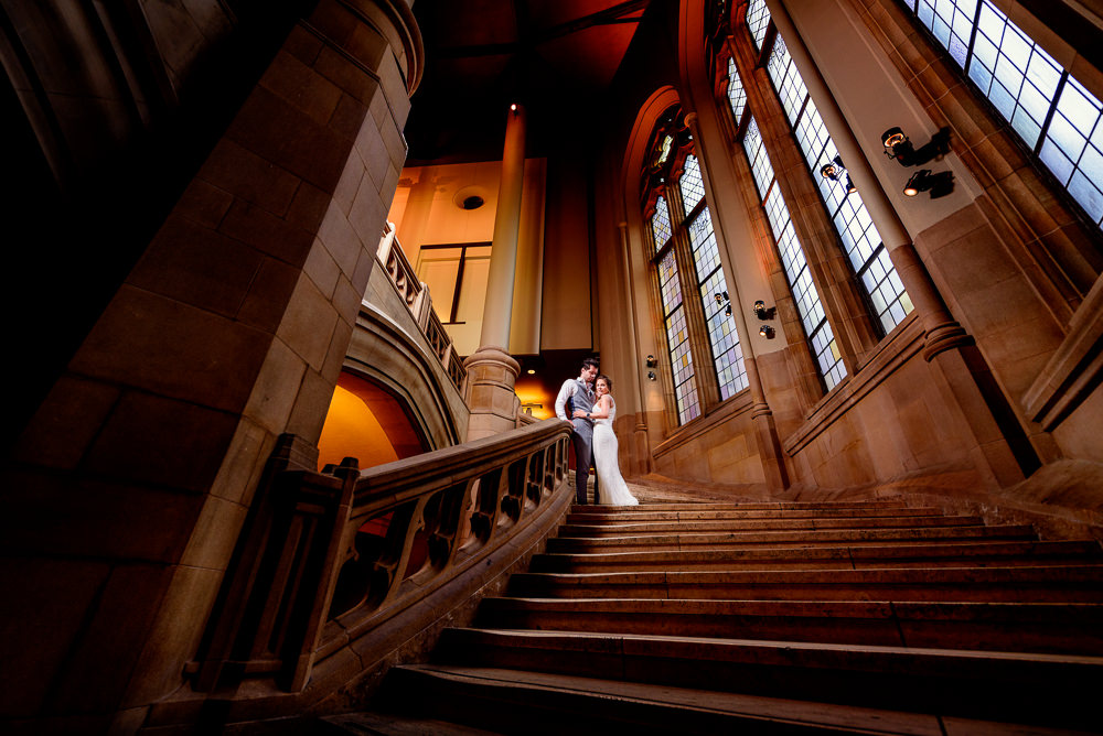 Couple standing on huge staircase in the Suzzallo library, Epic Couple's Session in Seattle, Lazzat Photography, Engagement photos, wedding photos
