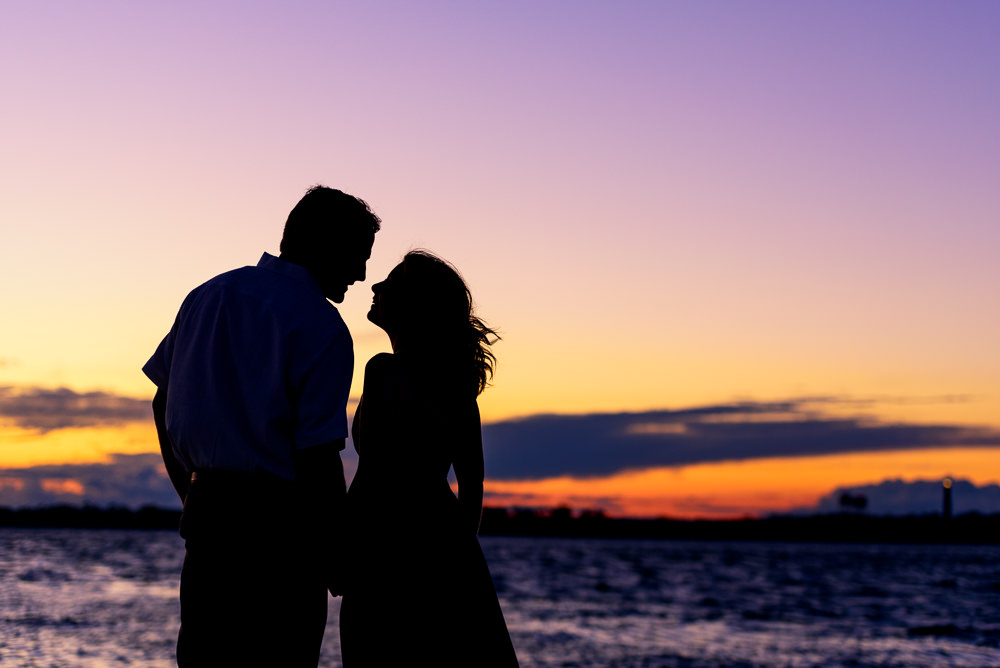 Silhouette of couple by the ocean at sunset, Fun Engagement Session at Eden Garden and Fort Pickens, Lazzat Photography, engagement photos