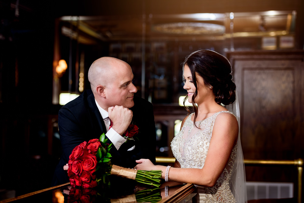 Groom looking at his Bride at The Pensacola Grand Hotel, Classic Red and White Wedding, Lazzat Photography