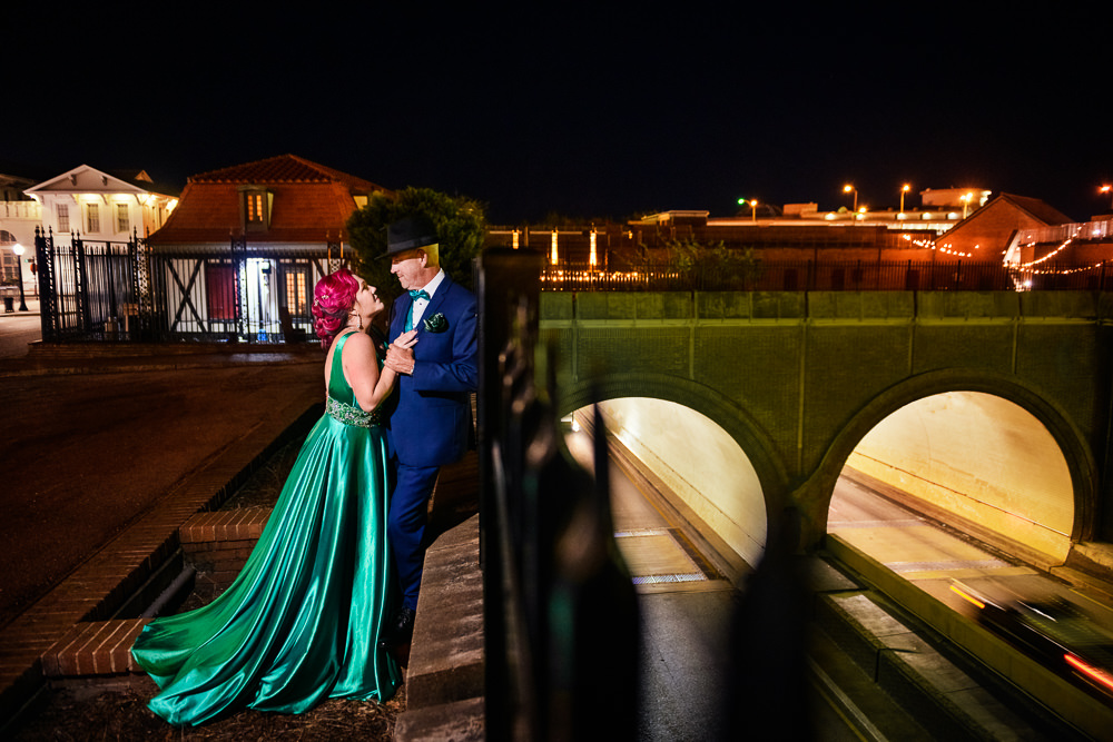 Couple leaning on the rail, green formal gown, pink hair, EPIC couple shoot, Lazzat Photography